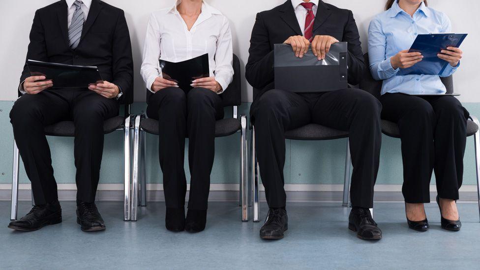 Job interview line (stock image)