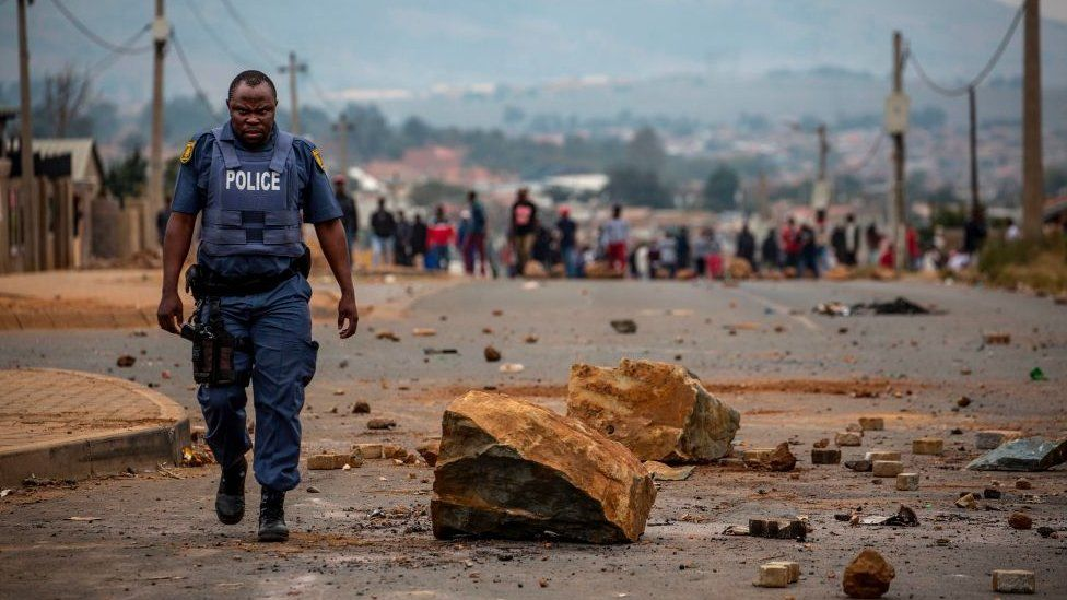 A South African police officer after a demonstration against land grabbing, housing and unemployment in Johannesburg.