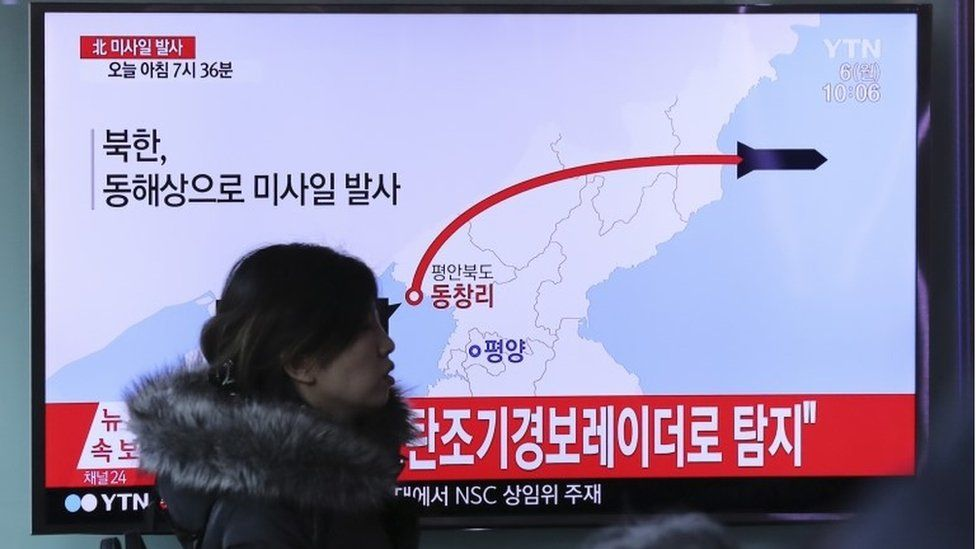 "A visitor walks by the TV screen showing a news program reporting about North Korea""s missile firing, at Seoul Train Station in Seoul, South Korea, Monday, March 6, 2017"