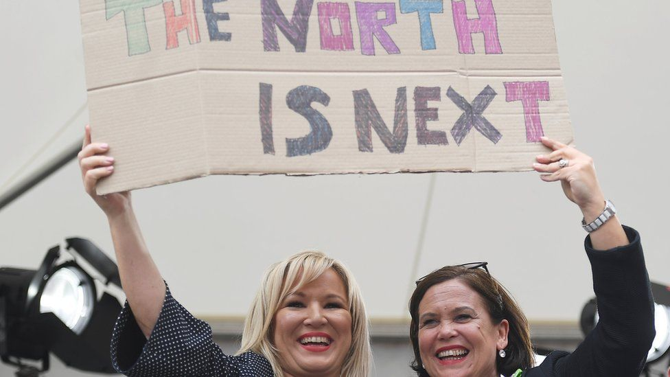 Sinn Féin's Mary Lou McDonald (right) and Michelle O'Neill hold up a placard as they celebrate the result of the abortion referendum in the Republic of Ireland