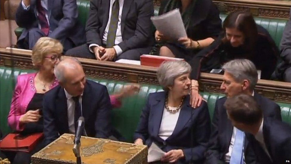 Colleagues congratulate Theresa May on her Commons speech