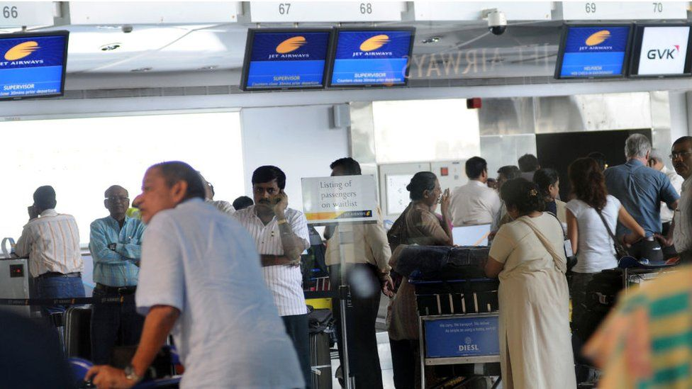 Jet Airways Pilots on Mass Sick Leave - Passengers at Mumbai Domestic Airport - Mobile Phones - Luggage - Business travellers run helter skelter as several Jet Airways flights were cancelled during peak departure hour - Flights displays went blank at Mumbai's domestic terminal 1.