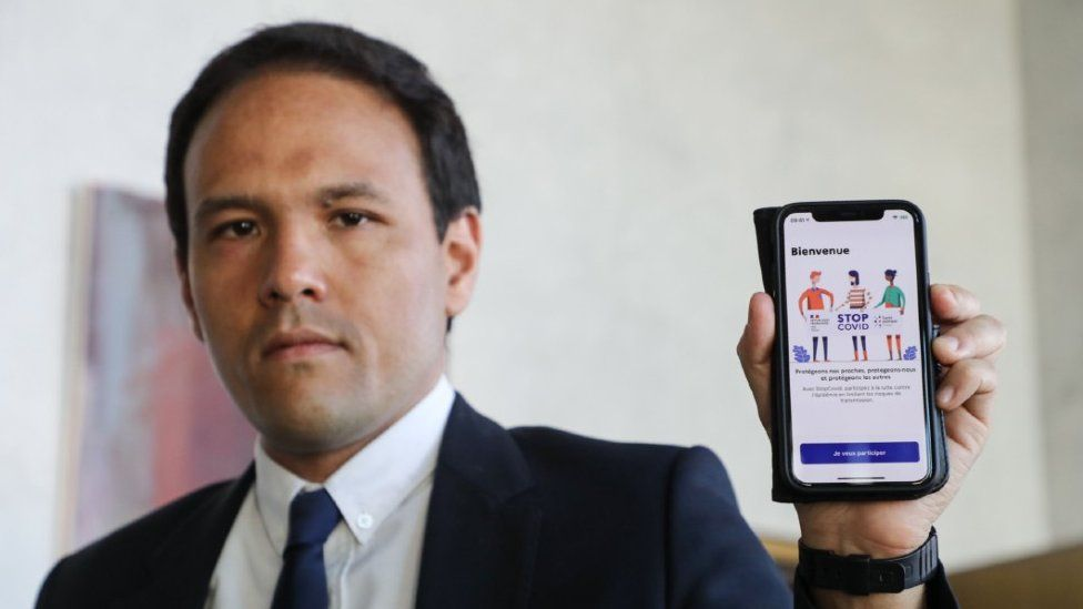 French digital economy minister Cedric O with the Stop Covid app