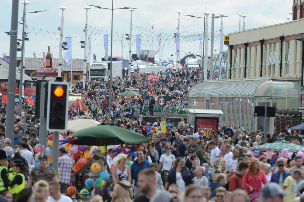 Thousands of people line the streets in Sunderland's Seaburn area