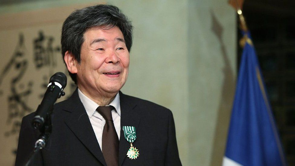 This picture taken on April 7, 2015 shows Japanese animation movie director Isao Takahata smiling as he received the 'Officier of L'Ordre des Arts et des Letters'