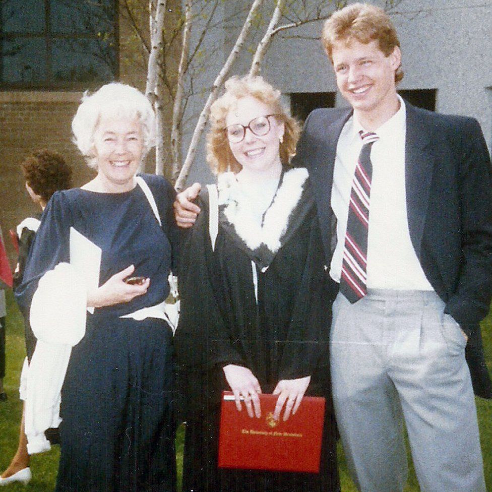 With her mum and brother on her graduation day from the University of New Brunswick in 1987