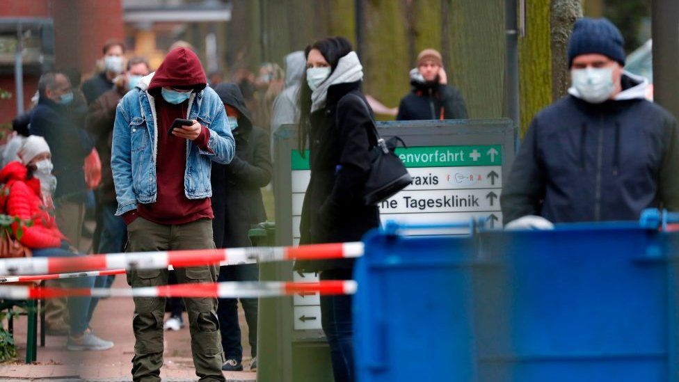 People outside a building in Germany waiting to get tested for Covid-19