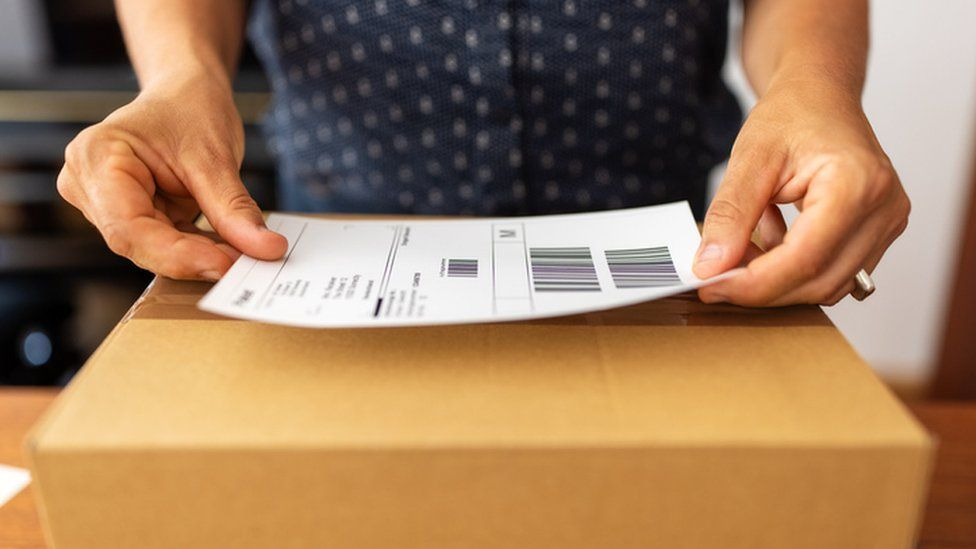 Woman online business owner preparing to ship parcel (file photo)