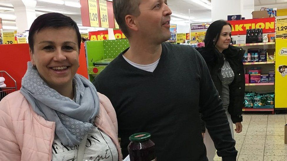 Czech shoppers Petr and Sarka in a supermarket in Altenberg, Germany