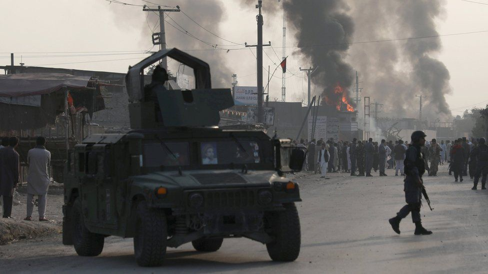 Policemen keep watch as angry Afghan protesters burn tires and shout slogans at the site of a blast in Kabul, Afghanistan September 3, 2019