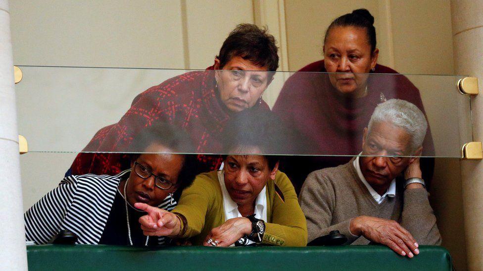 Audience members watch Mr Michel speak in parliament