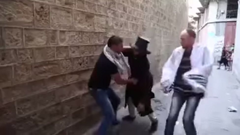 Freeze frame from Hamas instructional video depicting attack on Jews