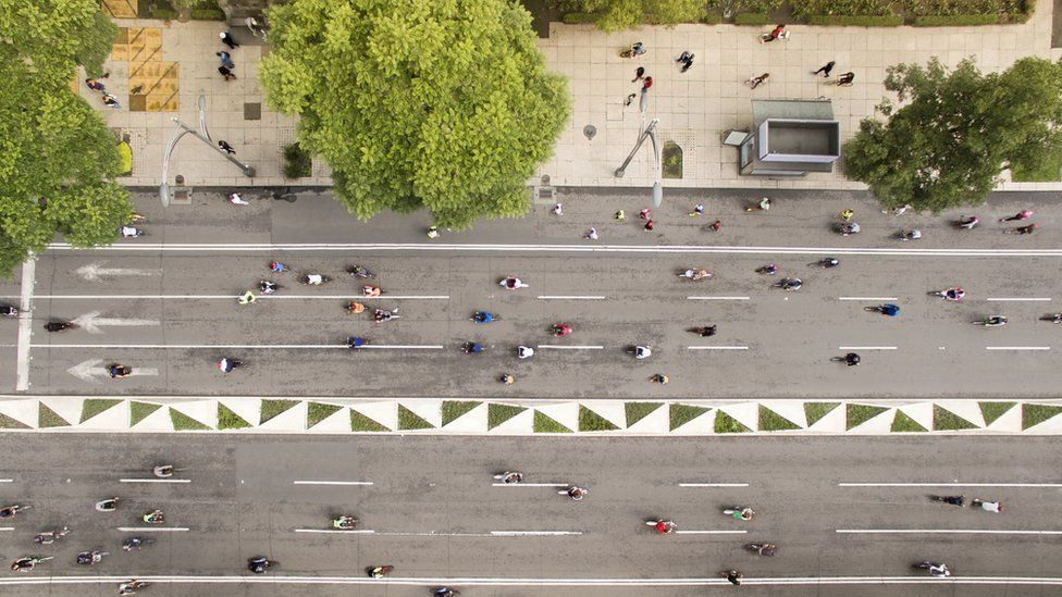 Aerial shot of people cycling at Reforma street in Mexico city.