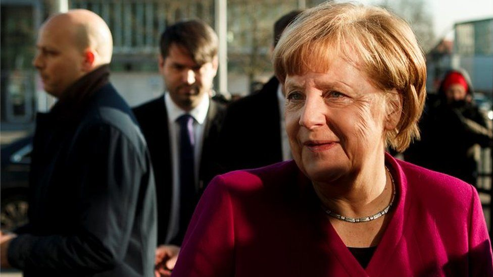German Chancellor and leader of the Christian Democratic Union (CDU) Angela Merkel speaks to the media about the coalition negotiations, 6 February 2018
