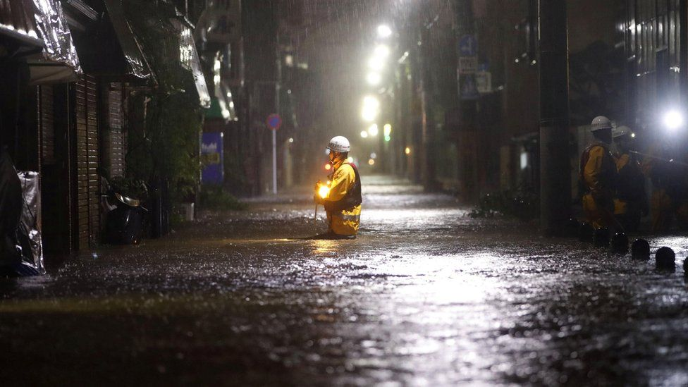 Firefighters patrol on a flooded road due to heavy rains caused by Typhoon Hagibis in Tokyo, Japan, 12 October, 2019.