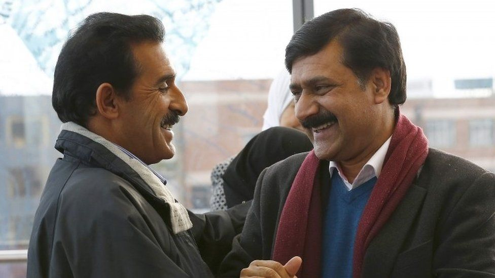 The father of Malala Yousafzai, Ziauddin Yousafzai (right) greets Rakan Almellehan the father of 17 year old Syrian refugee Muzoon Almellehan at the City Library in Newcastle-Upon-Tyne (22 December 2015)