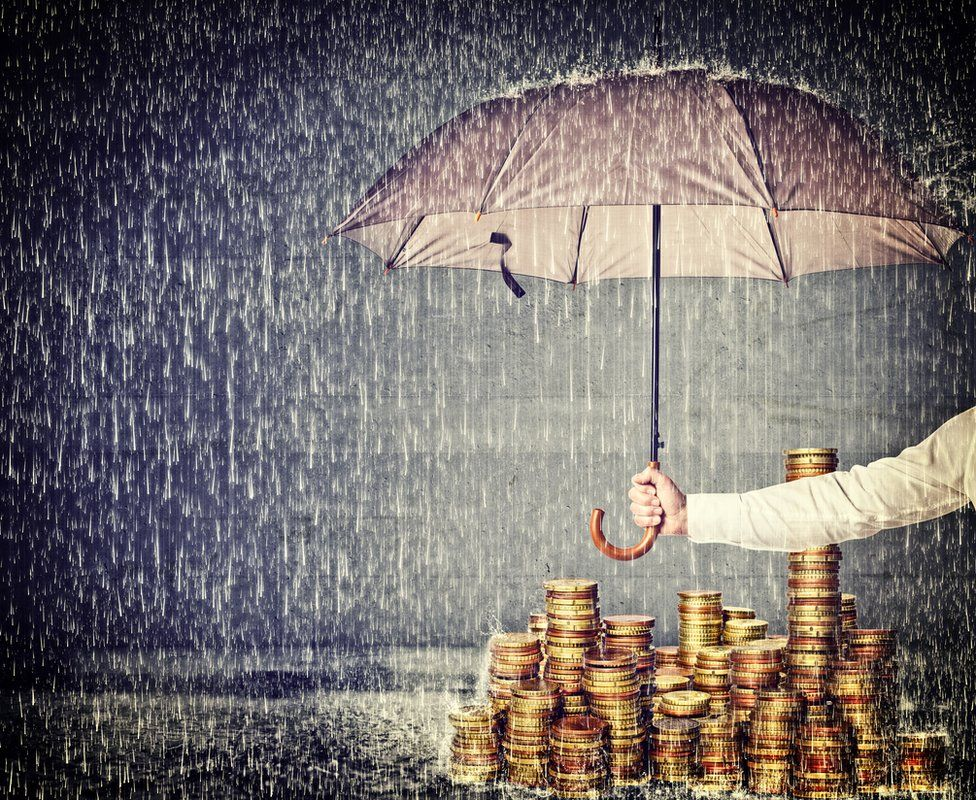 Umbrella over a pile of euros