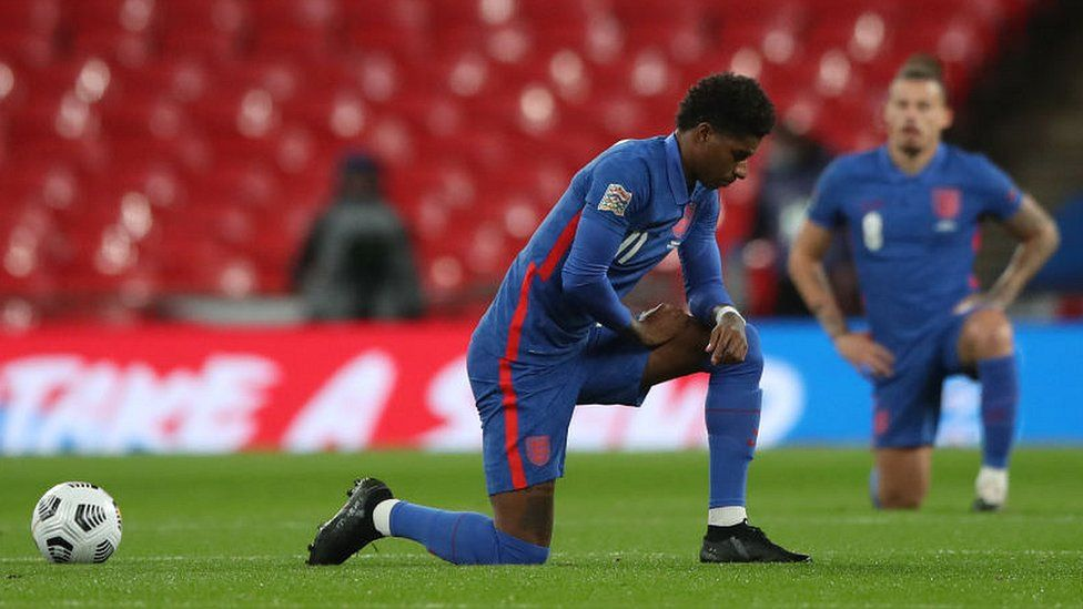Marcus Rashford taking the knee