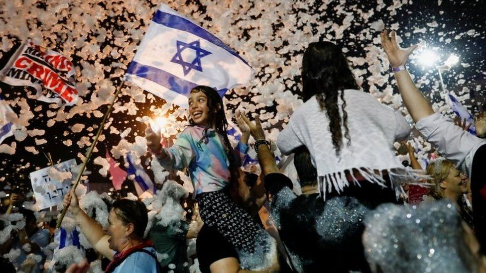 People celebrate in Tel Aviv after Israeli lawmakers approved a new government. Photo: 13 June 2021