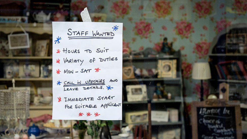 A job advert in a shop window