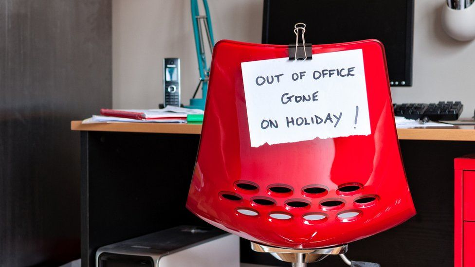 Out-of-office sign taped to chair