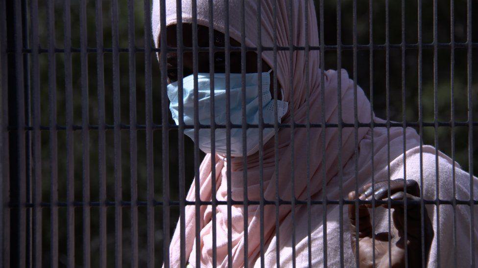 Woman in profile through the railings: Cameroonian Shantleen