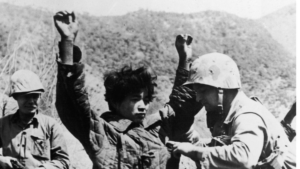 US soldiers carry out a search during the Korean War