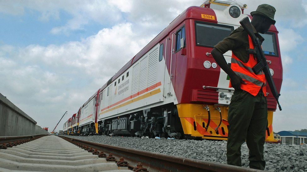 A security guard on patrol during launch of the first batch of Standard Gauge Railway freight locomotives at the port in Mombasa, Kenya on Wednesday, 11 Jan.