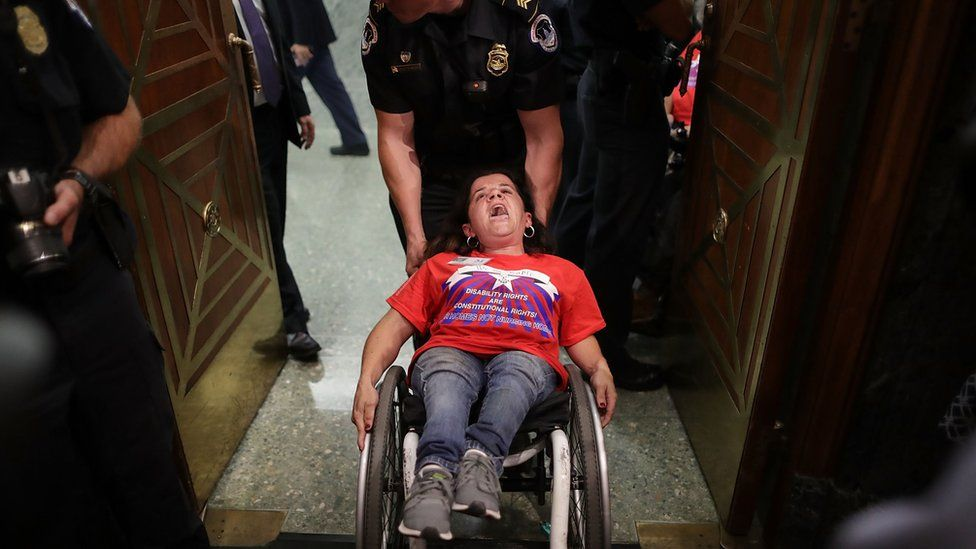 Colleen Flanigan is arrested by Capitol Hill police.