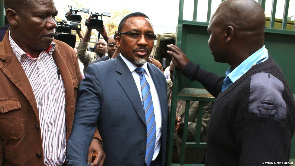 Pastor James Ng'ang'a of Neno Evangelism Center is escorted by police officers to the courtroom shortly before his hearing in Limuru, Kenya - 20 August 2015.