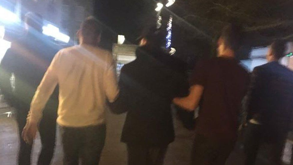 The off-duty police officers surrounded and arrested a suspect during their Christmas meal.