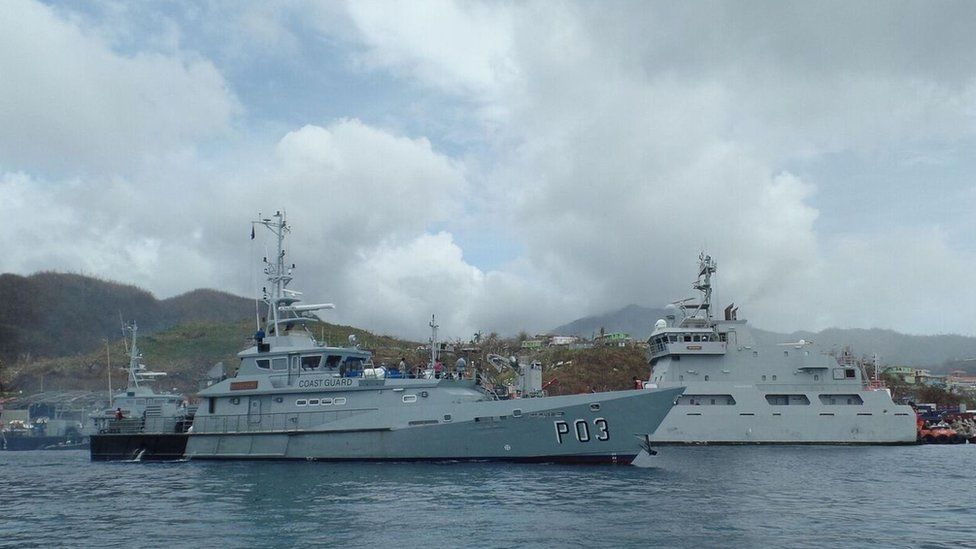 A Coast Guard ship can be seen off Dominica