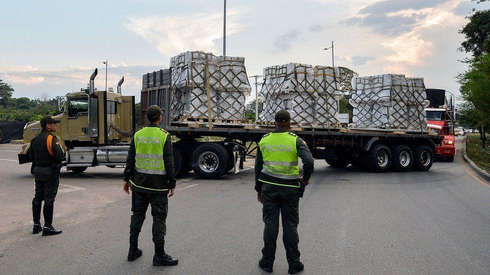 Trucks carrying aid drive towards the Colombia-Venezuela border