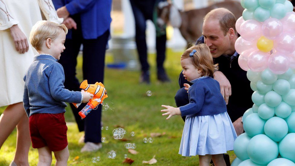 Prince George playing with a bubble gun