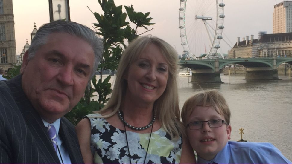 Paul Austin, his wife and their son
