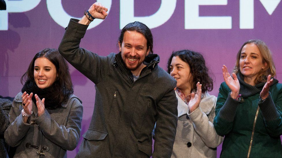 Podemos (We Can) leader Pablo Iglesias (2L) acknowledges his supporters after learning the final general elections results