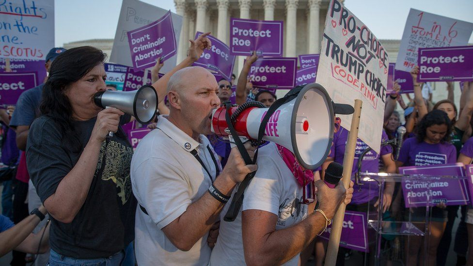 Pro-choice and anti-abortion protesters demonstrate in front of the US Supreme Court ahead of the announcement