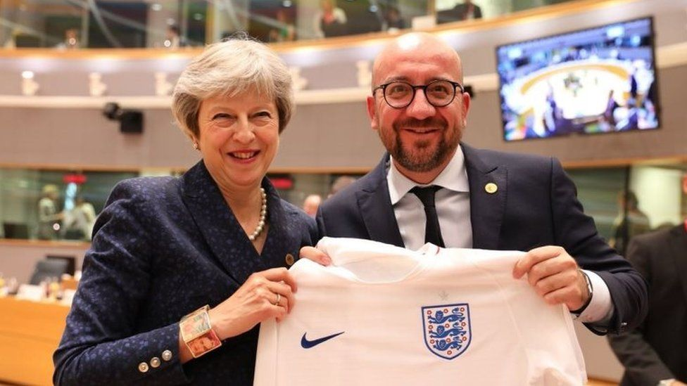Belgian Prime Minister and theresa May with an England shirt