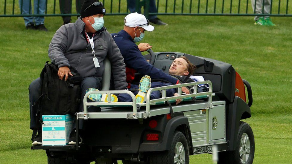 Tom Felton is carted off the course after collapsing during the celebrity matches ahead of the 43rd Ryder Cup at Whistling Straits