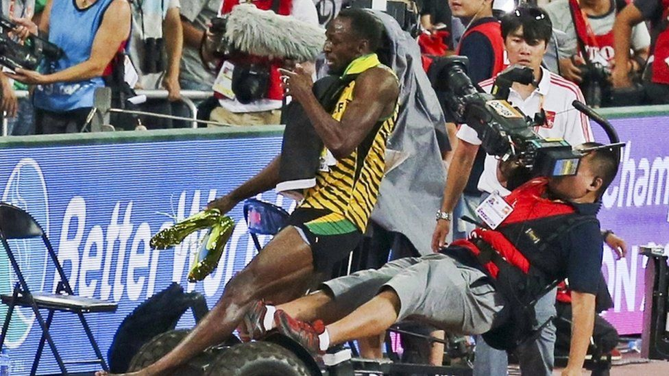 Sprinter Usain Bolt colliding with a cameraman on a Segway in 2015.