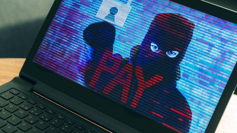 Criminal behind mask demanding money