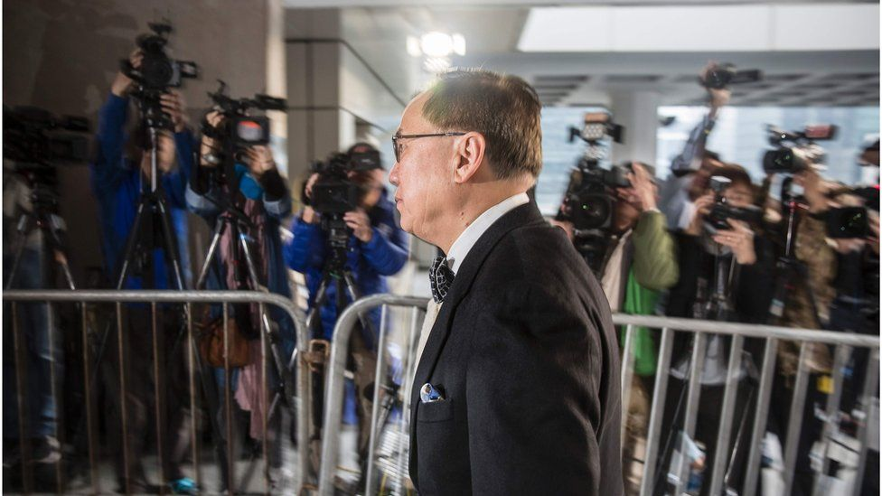 Mr Tsang arriving at court, walking past camera operators from the media. 3 January 2017.