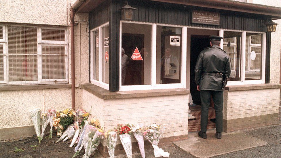 A police officer at the Heights Bar in Loughinisland after the attack in 1994