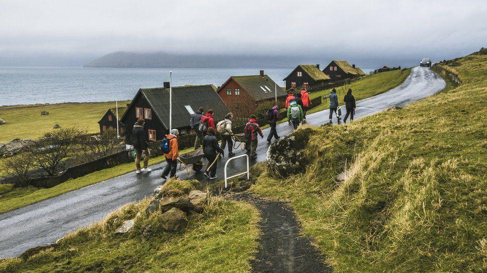 Brown Group members walk to the site in Kirkjubøur