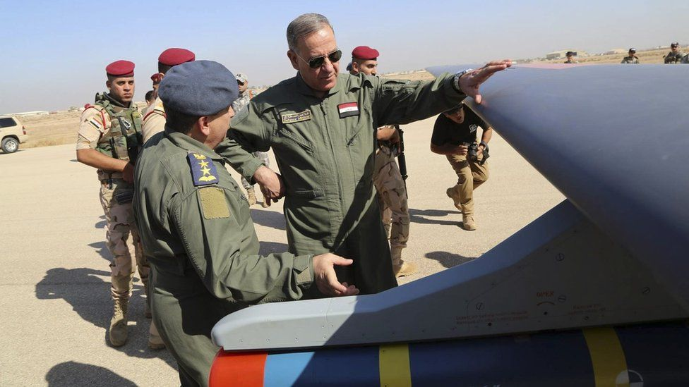 Iraqi Defence Minister Khaled al-Obeidi, centre, inspects the first drone to be used by the Iraqi Air Force Iraqi 10 October 2015