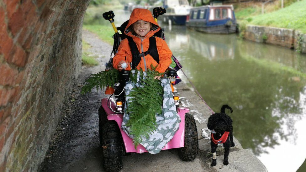 Carmela and her dog by a canal