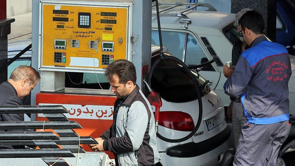 Iranians fill up their cars at a petrol station in the Iranian capital Tehran on October 20, 2015