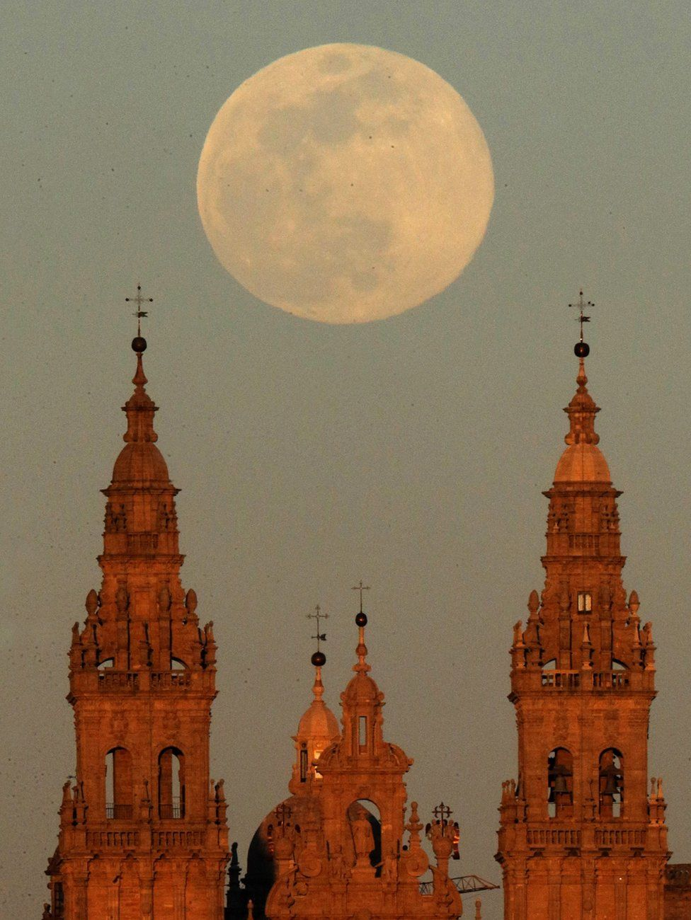 A view of the supermoon over the Santiago de Compostela cathedral in Spain