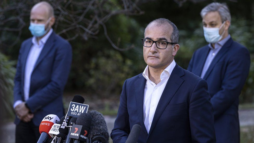 James Merlino (middle) at a press conference in Melbourne