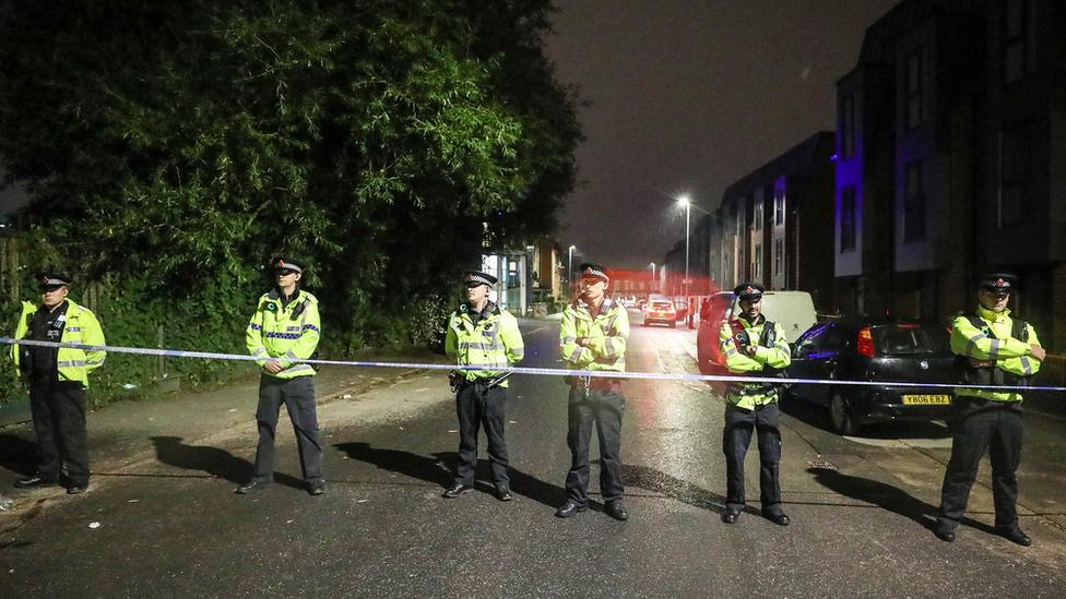Policemen at cordon